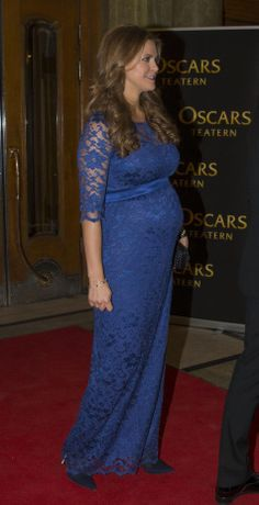 Swedish Princess Madeleine six months pregnant in Tiffany Rose dress as she attends for the special evening in honor of the 70 years of Queen Silvia of Sweden at the Oscar Theatre in Stockholm 19.12.13