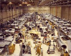 U.S. Navy Douglas A-4 Skyhawks in various stages of rework crowd a hangar at the Naval Air Rework Facility at the Naval Air Station Pensacola Florida circa 1980 [1900 1496]
