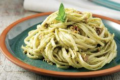Linguini with basil pesto and dried tomatoes