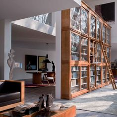 Home office. Custom made wall to wall library in a contemporary house.