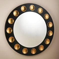 The dramatic and well scaled Domino Round from is made from American white oak veneer, stain, with exaggerated metal leaf pips. It hangs on a cleat system. Unique Mirrors, Round Mirrors, Convex Mirror, Mirror Mirror, Circular Mirror, Wall Accessories, Floor Mirror, Black Mirror, Mirrors