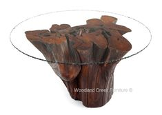 A massive natural tree stump is forever immortalized in this unique rustic dining table. The natural curved shape is perfect for sitting around. The top has incredible character, and the glass top allows you to look at mother nature's art work while enjoying your meals. We have a wide selection of tree bases that will