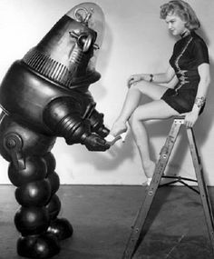 Robby the Robot & Anne Francis in a promo shot for Forbidden Plant c.1956