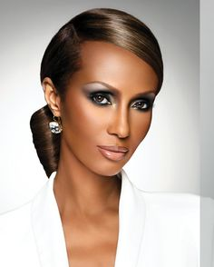 IMAN BIOGRAPHY... I love everything about this look.  Picture perfect; from her chic & sleek bun to her camera ready make-up.