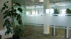 Frosted stripes to office glass partition walls for safety and privacy. Glass manifestation by space3.co.uk
