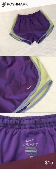 Women's Nike Shorts Women's Nike running shorts with built-in underwear. Worn several times but still in great condition! Sides are more of a neon yellow. Nike Shorts