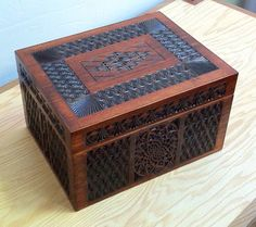 Handcrafted humidor.  All solid wood, no veneer, and it's carved!
