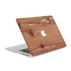 """A wooden skin to protect the back of your MacBook Pro 13"""". Each #WoodBack is handmade from real cedar, easy to remove and thinner than a credit card."""