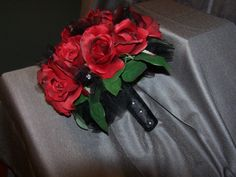 Bridesmaids Boquet Red Roses with black ribbon( silver ribbon??  or no black or nothing)