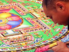 Tibetan monk working on details