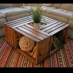Wood crate coffee table, add caster wheels and glass top! Fill with family photo albums and wicker baskets!