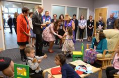 The Duke and Duchess of Cambridge receive teddy bears from five-year-old Hailey Cain during a tour of Sheway, a centre that provides support for native women.