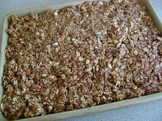 coconut oil granola bars    1/2 cup peanut butter or sunbutter  1/3 cup honey  1/4 cup coconut oil (or another oil of your choice)  1 cup oats  1 cup total of any combination of:  sesame seeds, coconut flakes, sunflower seeds, dried fruit, mini chocolate chips  In a medium sized saucepan, melt together peanut butter, honey and coconut oil.    Remov