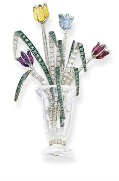 A ROCK CRYSTAL, MULTI-GEM AND DIAMOND BROOCH, BY MICHELE DELLA VALLE Designed as a rock crystal sculpted vase, holding a spray set with amethyst, citrine, aquamarine and ruby tulips with brilliant-cut diamond stems, to the emerald-set leaves, mounted in 18k white gold,