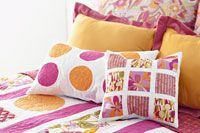 Piece squares or machine-appliqué circles to create two easy pillows.