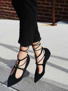 Isabelle Lace Up Flat   Suede flats with strappy adjustable buckle detailing along the body and pointed toe silhouette. Lace-up accents that tie up the ankle for a chic look.