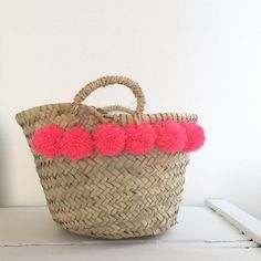 Mini Pom Pom Basket — Fuchsia at La Frau, $16.37Seagrass baskets are one of my favorite ways to organize loose odds and ends at home. I couldn't resist the added flair of these hot pink pom poms (and neither should you).