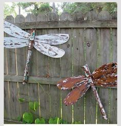 old ceiling fan blades would work to make these and stair ballisters for the body.