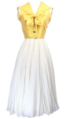 Dress  1950s Like the idea of having a different coloured bodice to the skirt. Love the bow.