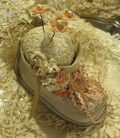 An adorable pin cushion-what a sweet gift to give to an expecting daughter in law -made from your son's old baby shoe!