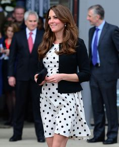 26 April 2013: Kate turned to the high street for her maternity look in this snapshot. Pictured visiting the Harry Potter studios with Wills and Harry in London, Kate opted for a Topshop polka dot dress that suited the occasion perfectly. [Corbis]