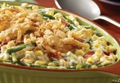 Not the usual Green Bean Casserole - made with bacon, corn, cream cheese, green beans, mayo, French fried onions