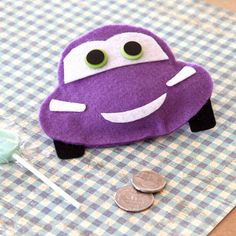 Everyone will be smitten with your purple coin purse modeled after the Holly Shiftwell from Cars 2!