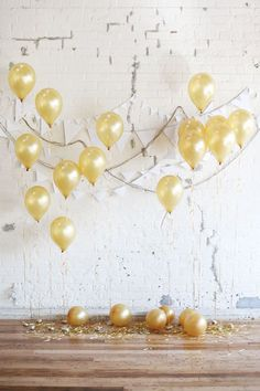A Background That Pops: This DIY wedding backdrop would be perfect for a holiday-inspired wedding reception. Featuring balloons and bunting, it's a simple project to make.