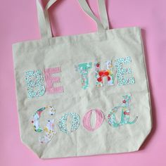Learn how to cutout letters out of fabric and apply them to a bag.