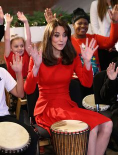 Catherine, Duchess of Cambridge takes part in some drumming 'music therapy' as she attends the Anna Freud Centre Family School Christmas Party at Anna Freud Centre on December 15, 2015 in London.