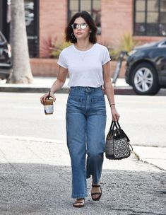 Look for Less: Lucy Hale in Velvet by Graham & Spencer Tee, Wide Leg Jeans, and Salvatore Ferragamo Bag Basic Outfits, Summer Fashion Outfits, Classy Outfits, Casual Outfits, Lucy Hale Outfits, French Minimalist Wardrobe, Lucy Hale Style, Stylish Dress Designs, Celebrity Outfits