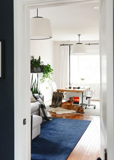 Home office essentials that look good in your home // attractive cord management, chairs, filing cabinets, mail organizers and more // via Yellow Brick Home Sectional Coffee Table, Plum Walls, Bali Blinds, Long Room, Open Concept Home, Simple Desk, Office Essentials, Room Lights, Ceiling Lights