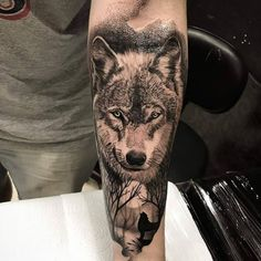 No photo description available. Wolf Tattoo Forearm, Wolf And Moon Tattoo, Tribal Wolf Tattoo, Forearm Tattoo Design, Wolf Tattoo Design, Wolf Tattoos Men, Baby Tattoos, Tattoos For Guys, Animal Sleeve Tattoo