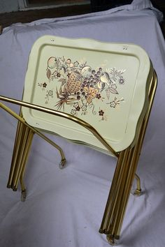 metal TV tray tables... to eat our TV dinners on - seemed everybody and their brother had a set of these