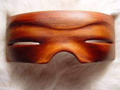 Inuit snow goggles carved from a single block of red cedar wood.  One of Christopher Oberg's ethnographic art reproductions.