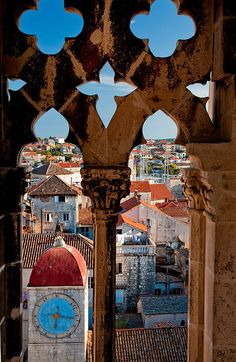 Clocktower, Trogir, Croatia. Alright for real, great use of cutouts and negative space; especially with the sky-blue clock in the background!!
