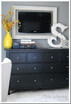 DIY bedroom ideas!  They used curved shower rods for curtain rods on each side of a large window. Frame around tv.  Made a file cabinet out of a hinged ottoman.