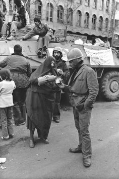 Motherly care, Tehran, February 9, 1979  Tea and bread sustained a revolution. After soldiers joined the demonstrations, civilians brought provisions into the streets.
