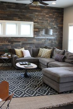 living room with sectional and rustic wall | Suburban Bitches