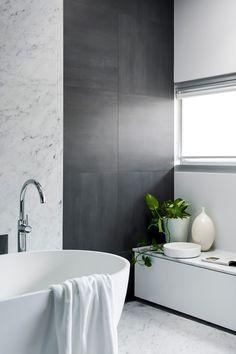 Minosa Design: Understated elegance creates a stunning bathroom.