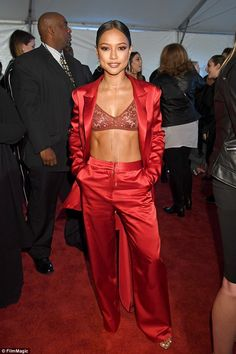 Hot mama!On Sunday, Karrueche Tran, 28, showed up at the iHeartRadio Music Awards in a super hot satin two-piece suit and lace bra
