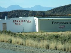 I DROVE PAST THAT! Only a sexshop by name. It is a cafe along Route 62 in South Africa. It used to be just Ronnies Shop, but some friends of Ronnie tried to be funny and painted Sex on the wall, so it became Ronnies Sex Shop. Love Home, South Africa, My House, Road Trip, Xhosa, To Go, African, Painting, Humor