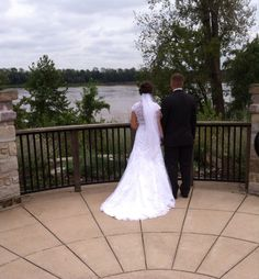 Bride and groom looking at the river