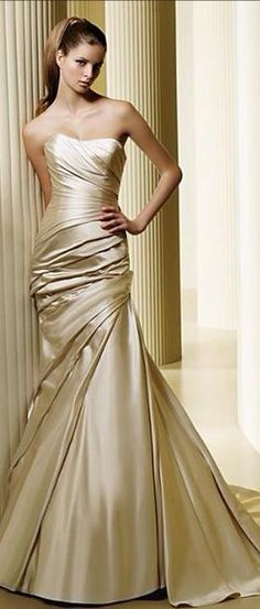 Champaign color strapless gown with drapes