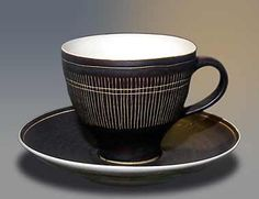 """Lucie Rie cup and saucer - 3⅛"""" (79 mm) high. Sgrafitto on manganese."""
