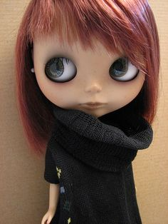 Red head Blythe doll with a fantastic hair cut. Love that jumper!