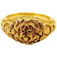 Antique Gold Memorial Ring Caroline of Brunswick Wife of George IV. Lovely ornately chased 18K gold Georgian memorial ring dedicated to Queen Caroline of Brunswick. She was married to the future George the IV who was already married illegally to Maria Fitzherbert. Nine months after the wedding Caroline had a child, Princess Charlotte of Wales, and she and George separated. She was very popular in England and George was despised for his immoral behavior...c 1821