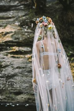 Veil covered in fresh flowers   Lara Hotz Photography for Hooray Magazine with styling by Stefanie Ingram, beauty by Liv Lundelius Makeup Artist and floral design by Jardine Botanic Floral Styling   see more on: http://burnettsboards.com/2014/07/ophelia-enchanting-fashion-boudoir-editorial/