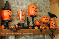 shop around or buy after Halloween for next year to create this whimsical mantle - I'd put flamless candles in the small pumkins along the mantle