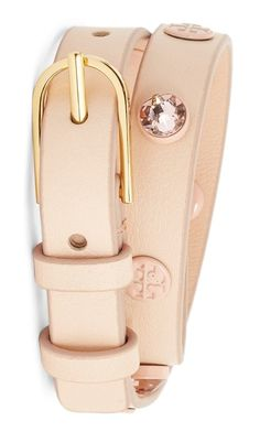 Tory Burch logos and light-catching rhinestones stud this double-wrap bracelet made adjustable by the gilded buckle.